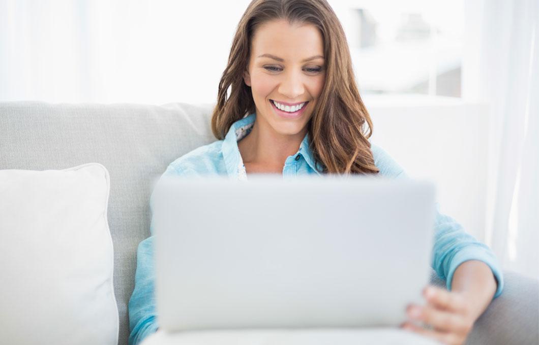 Woman smiling laptop
