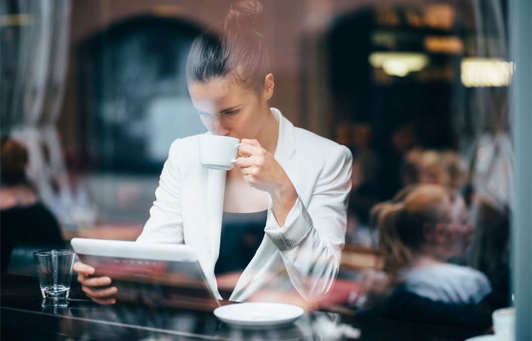 Woman reading tablet in coffee shop