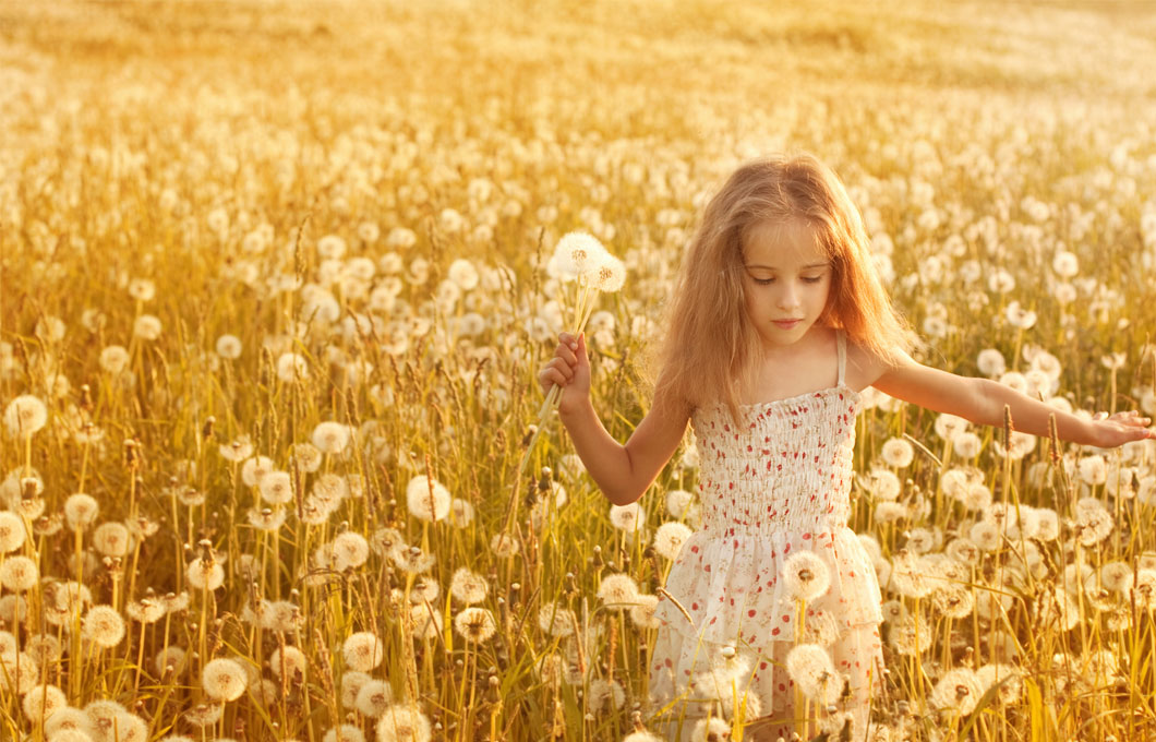 girl among dandelions